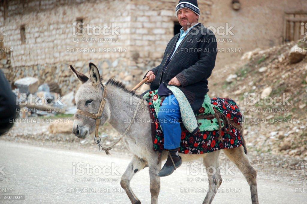 Man riding on donkey stock photo