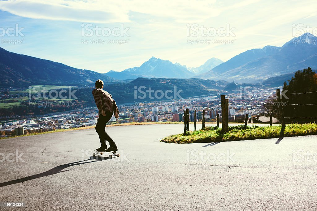 Man riding on longboard stock photo