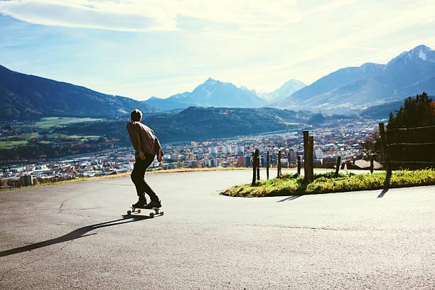 Man riding on longboard stock photo
