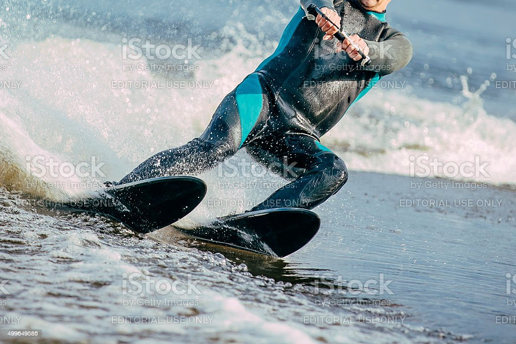 man riding on water skis stock photo