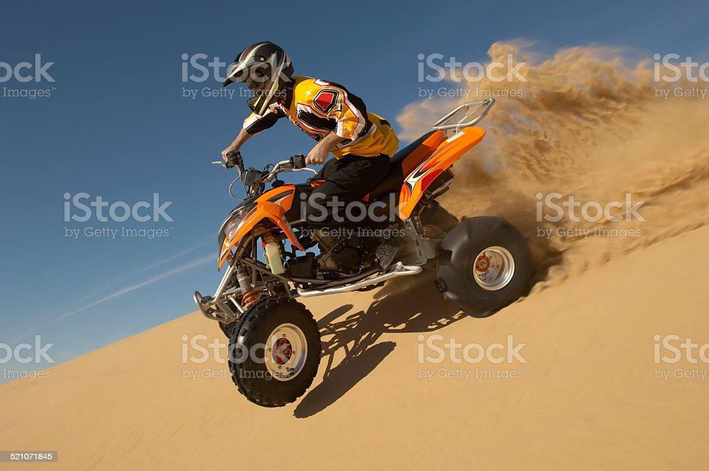 Man Riding Quadbike In Desert stock photo