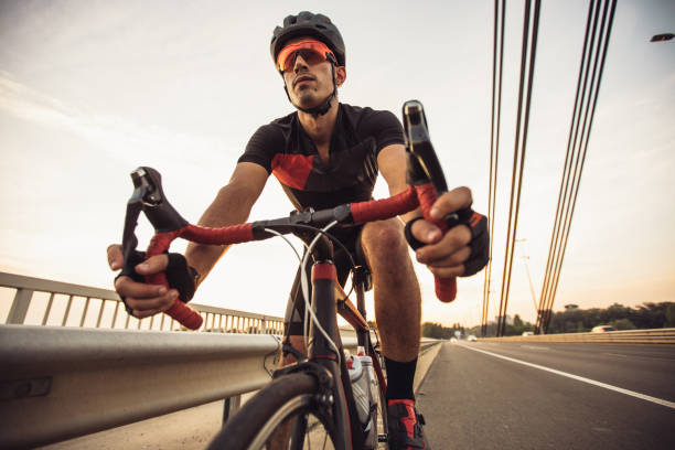 Man riding racing bicycle on the street stock photo