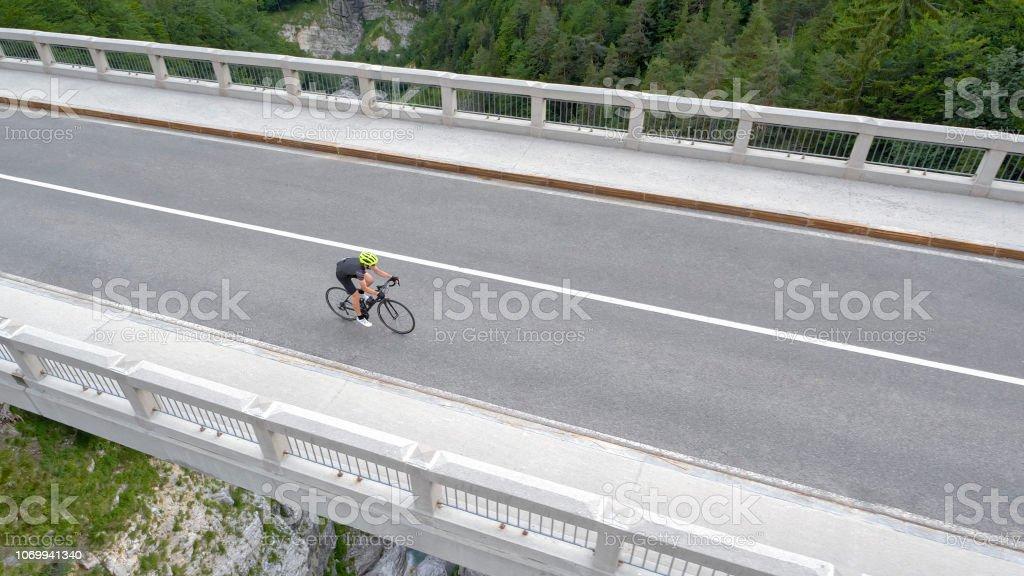 Man Riding Road Bike On Bridge Stock Photo - Download Image Now - iStock