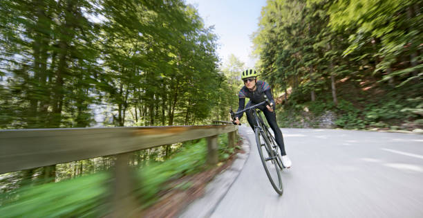 Man Riding Road Bike On Mountain Road Stock Photo - Download Image