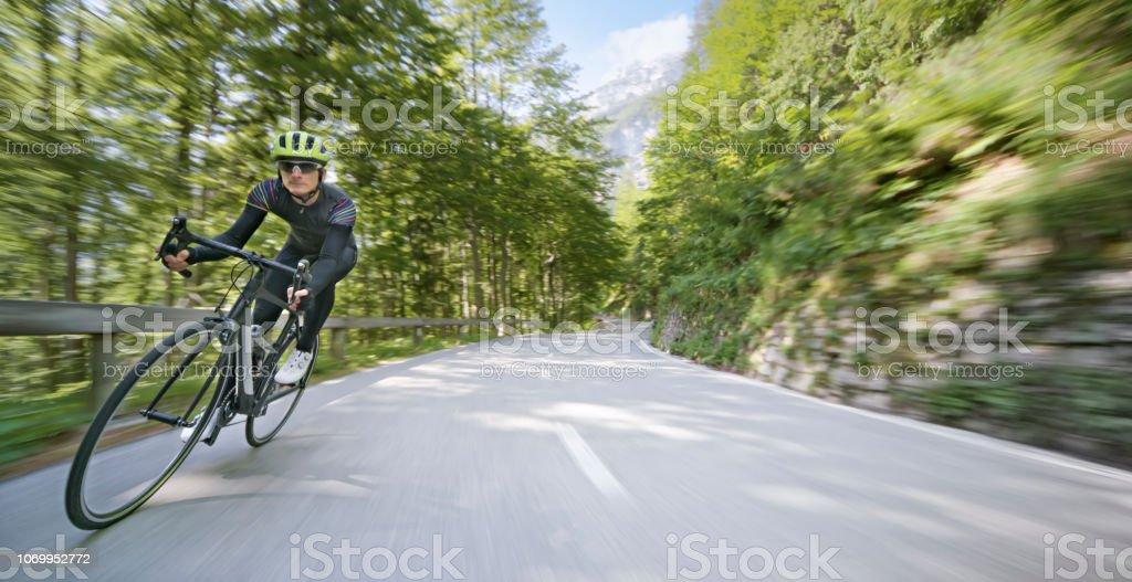 Man Riding Road Bike On Mountain Road Stock Photo - Download