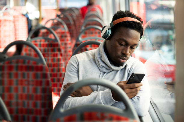 Man riding the bus alone stock photo