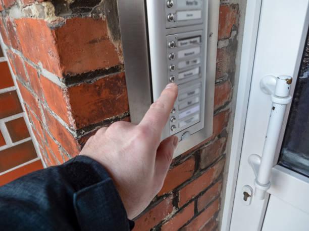 Man rings the doorbell