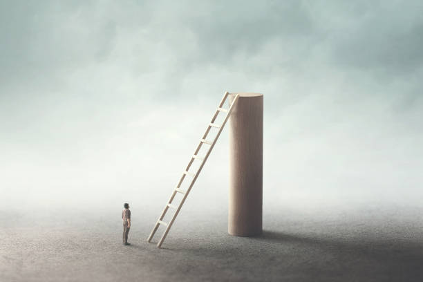 man rise stairs to reach the top of the tower stock photo