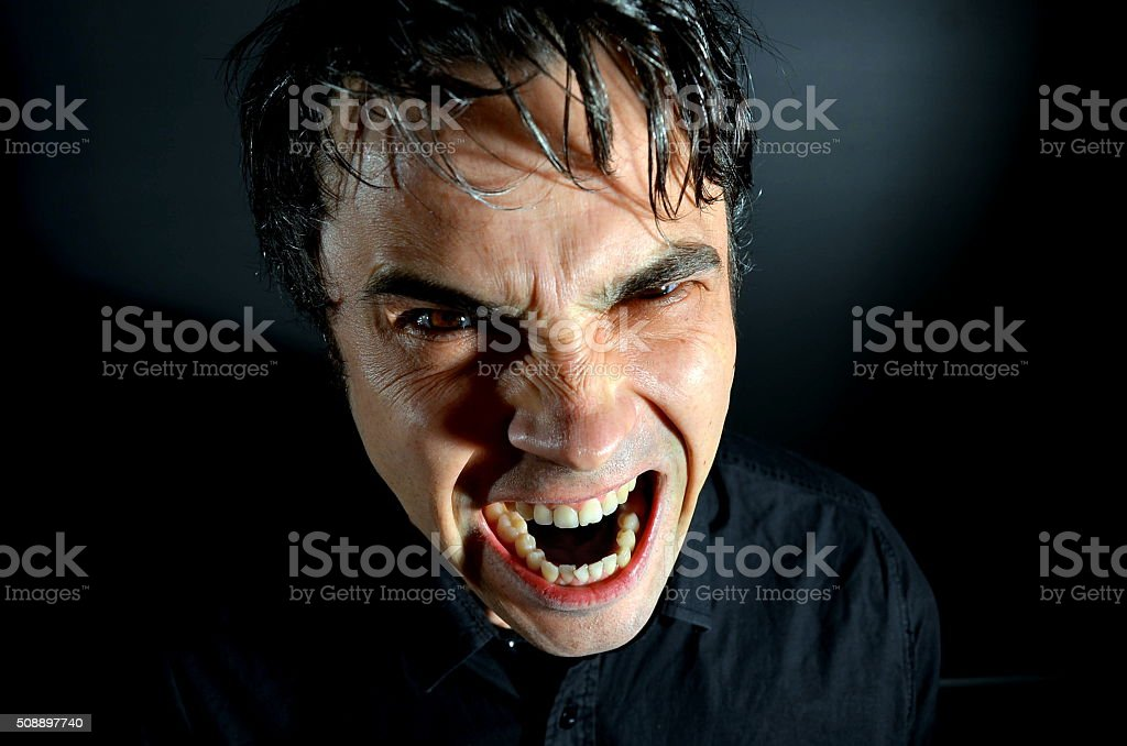 Man roaring stock photo