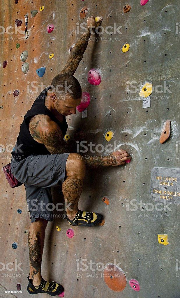 Man Rock Climbing Indoors royalty-free stock photo