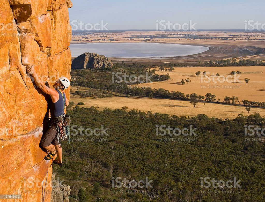 Man rockclimbing stock photo