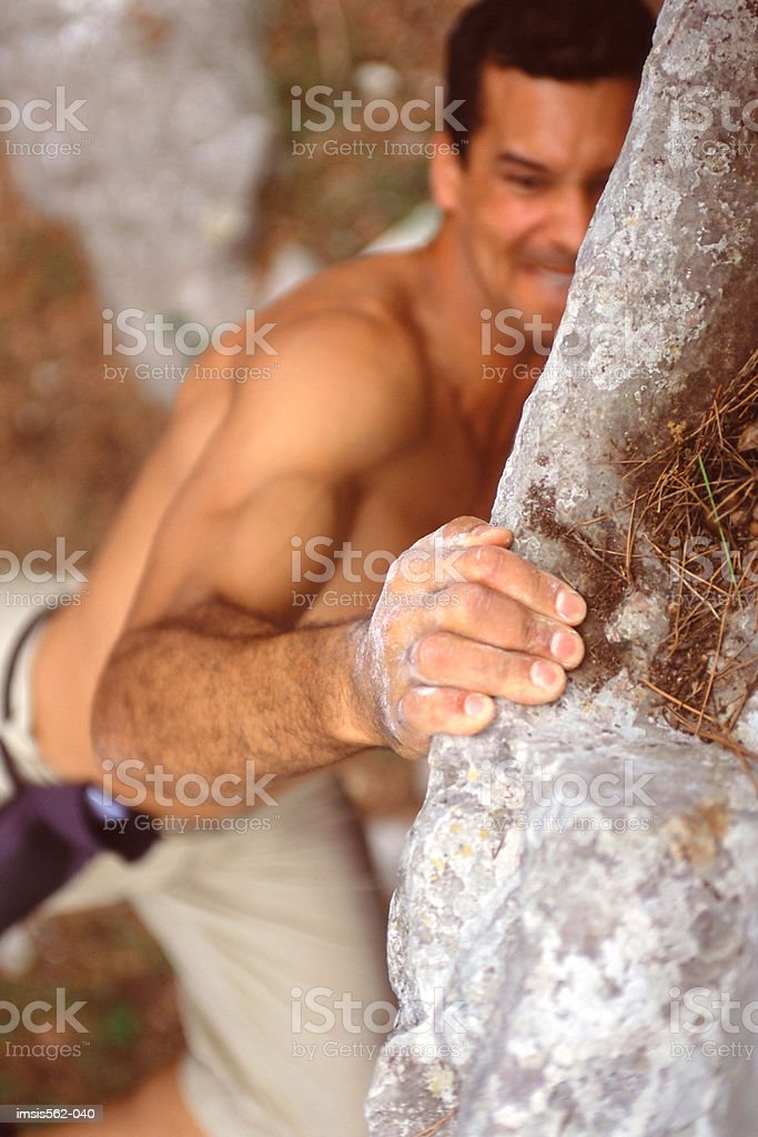 Man rock-climbing royalty-free stock photo