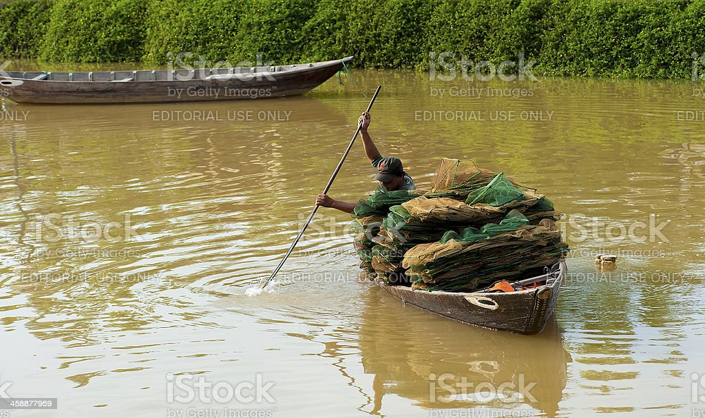 Man rowing a boat with the fishing net royalty-free stock photo