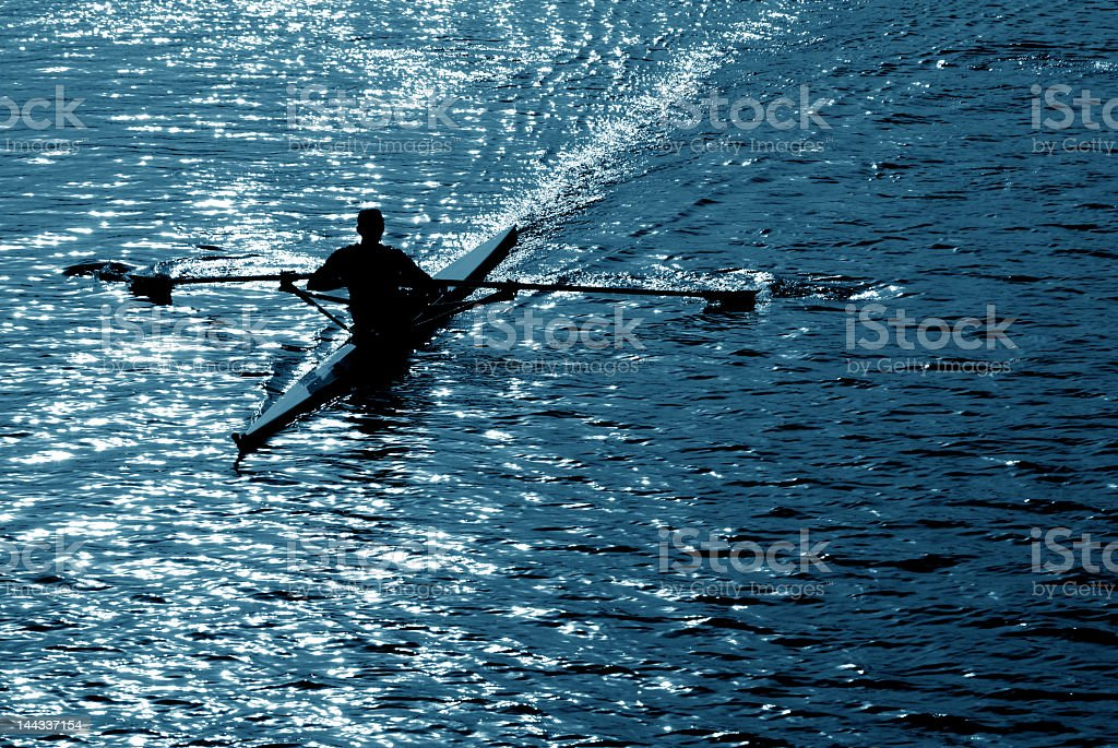 A man rowing in a lake alone in a kayak royalty-free stock photo