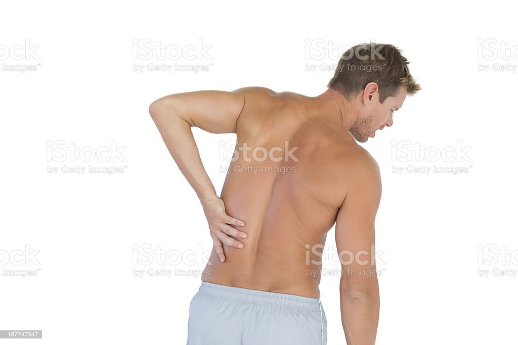 Man rubbing his back because of a pain royalty-free stock photo