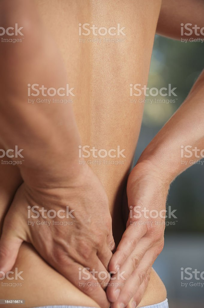 Man rubbing his lower back. royalty-free stock photo