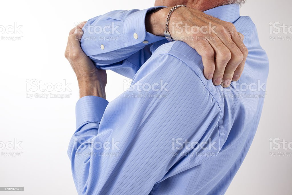 Man rubs shoulder in pain.  Backache. royalty-free stock photo