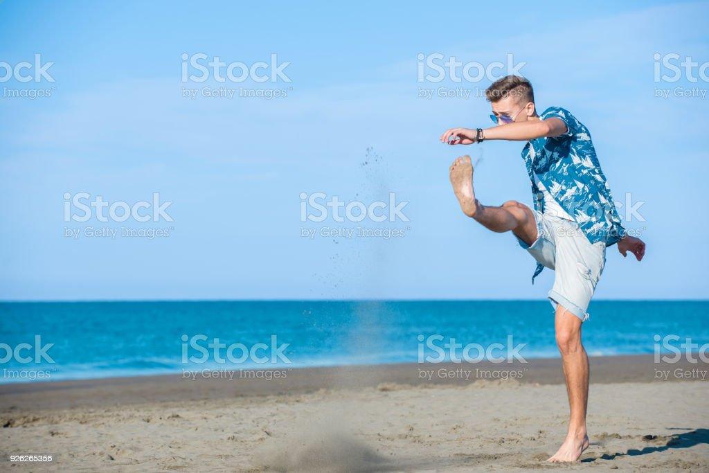 Man runing on the beach stock photo