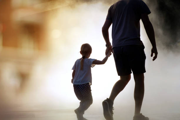 man runing / rescue wiith child from fire stock photo