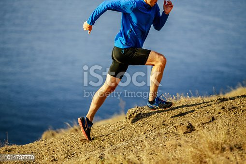 man runner dynamic running on steep slope of mountain