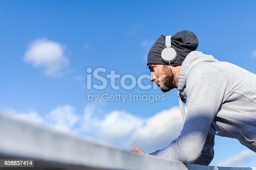 917307226 istock photo Man runner listening music on his smart phone 638837414