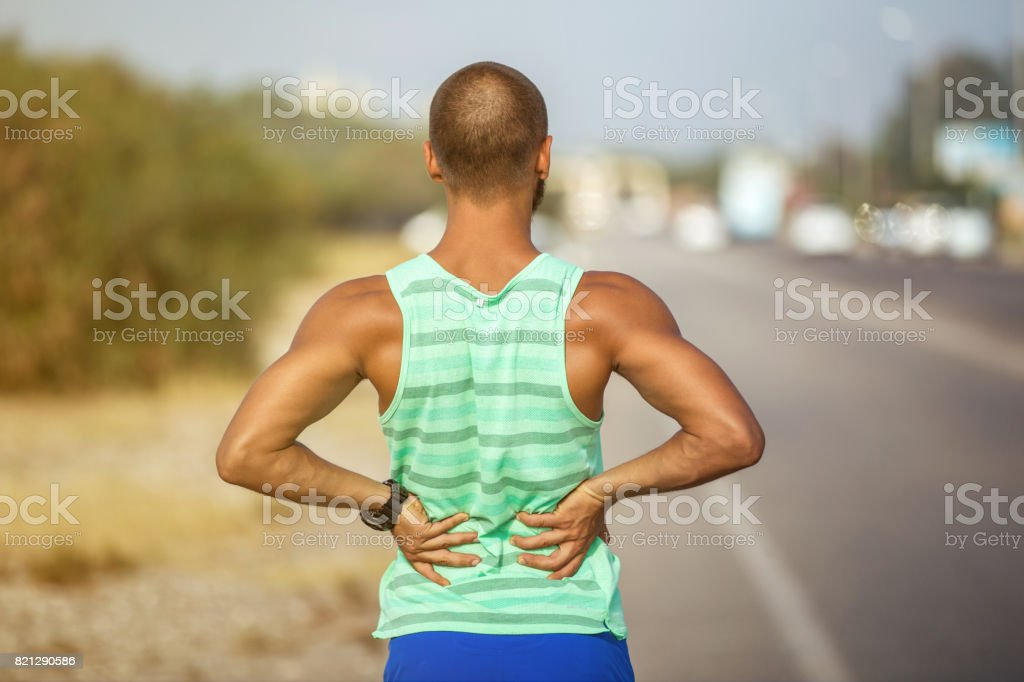 Man Runner lower back pain injury stock photo