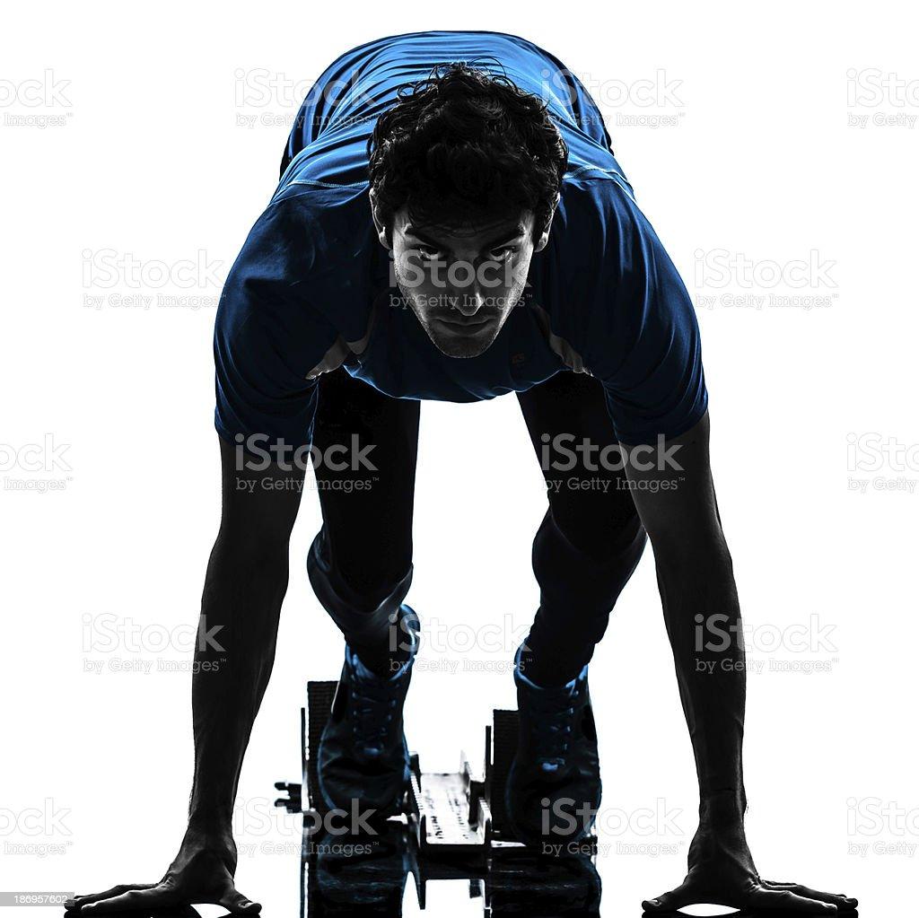 man runner sprinter on starting blocks silhouette stock photo