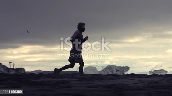 Young man running near glacier