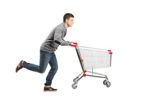 Man running and pushing an empty cart