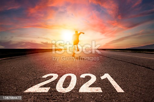 man running and sprinting on road with celebration 2021 new year concept
