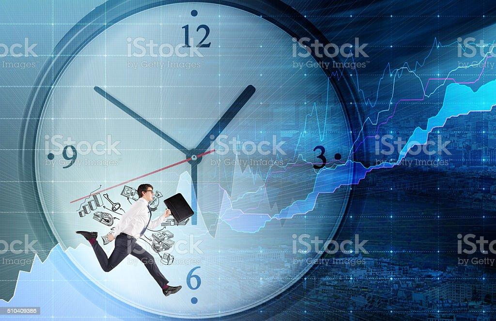 man running around a clock stock photo