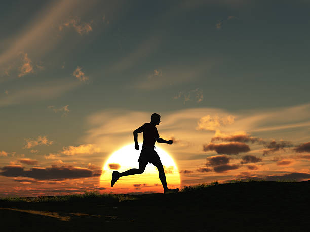 Man running at dawn stock photo