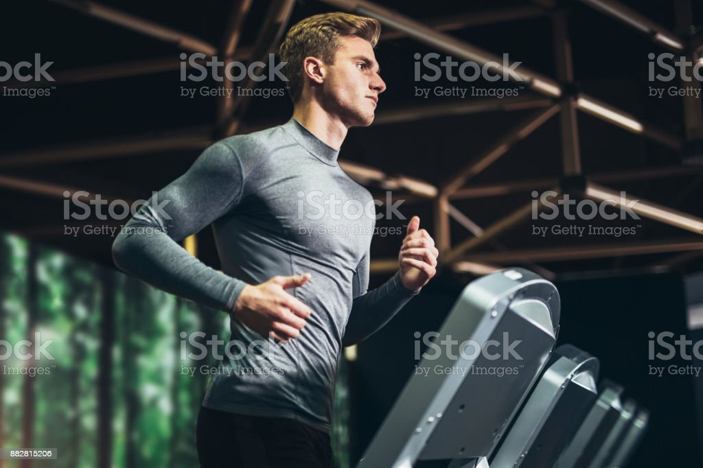 Man running at the gym stock photo