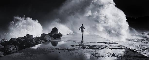 Man running away stock photo