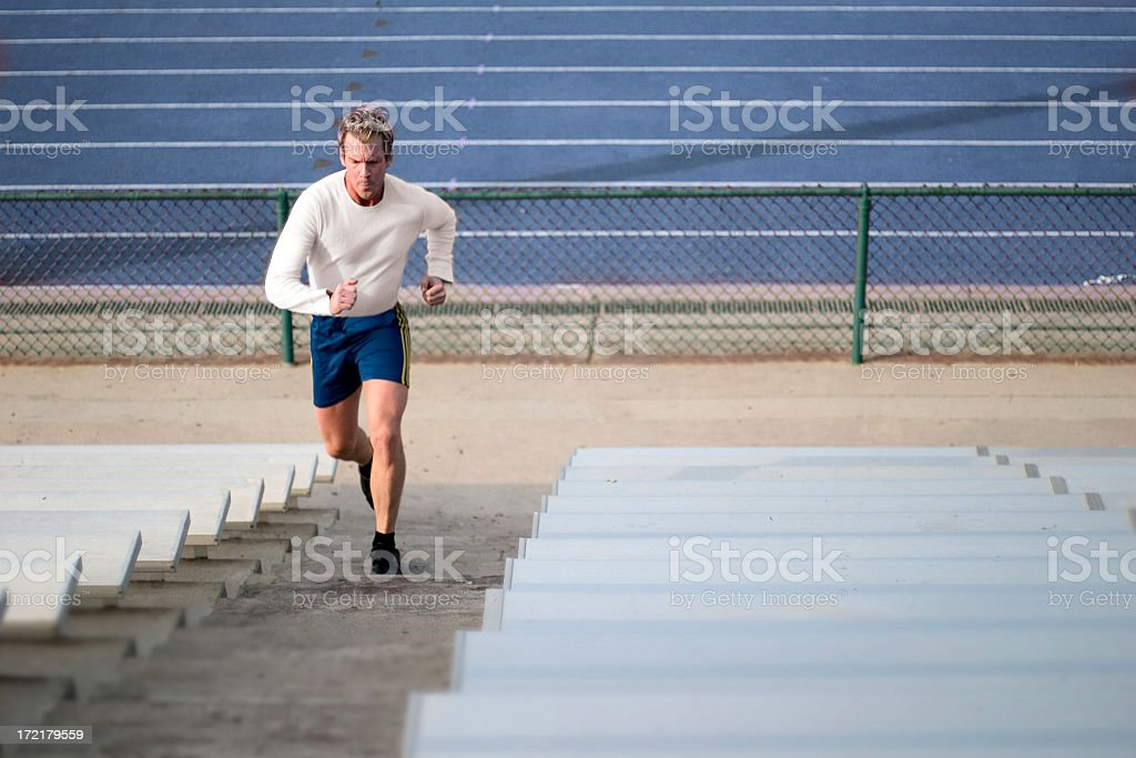 Man running bleachers to maintain health and strength royalty-free stock photo
