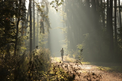 istock A man running during the sunrise 1180580660