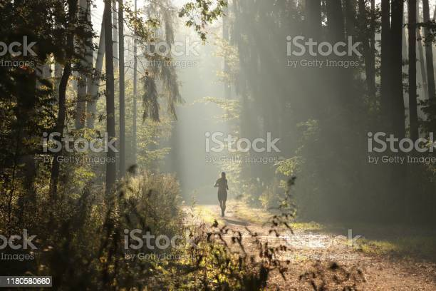 Photo of A man running during the sunrise