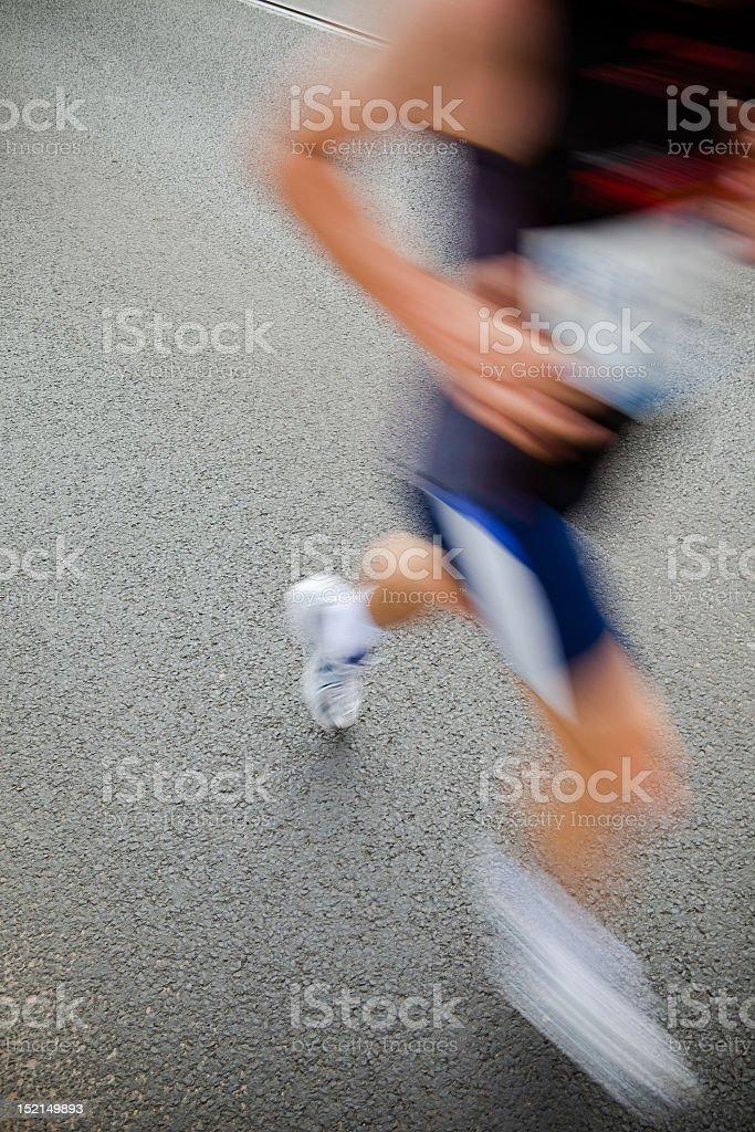 Man running in city marathon - motion blur royalty-free stock photo