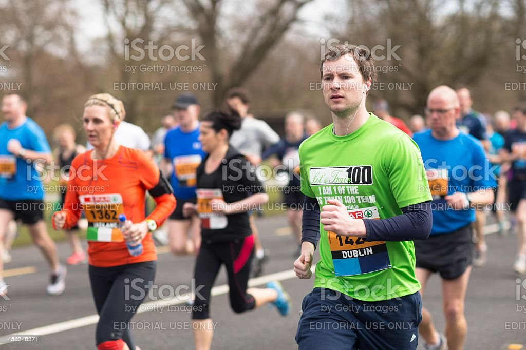 Man running in marathon stock photo