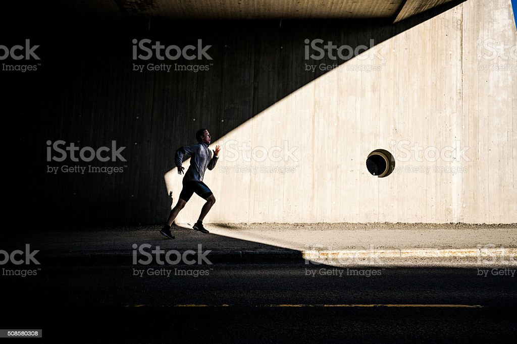 Man running in the city in early morning stock photo