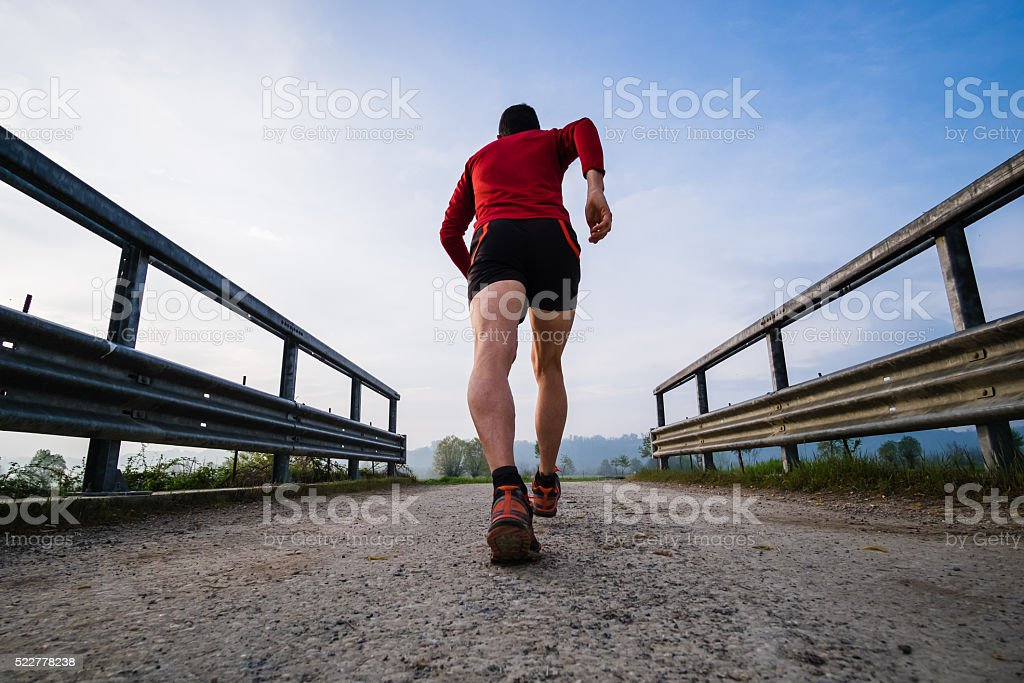 Man running in the country early in the morning stock photo