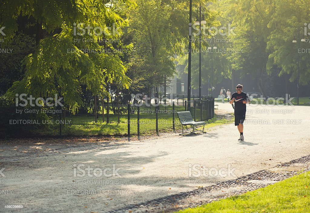 Man running in the park stock photo