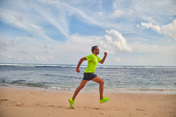 Man running / jogging on a tropical exotic beach. stock photo