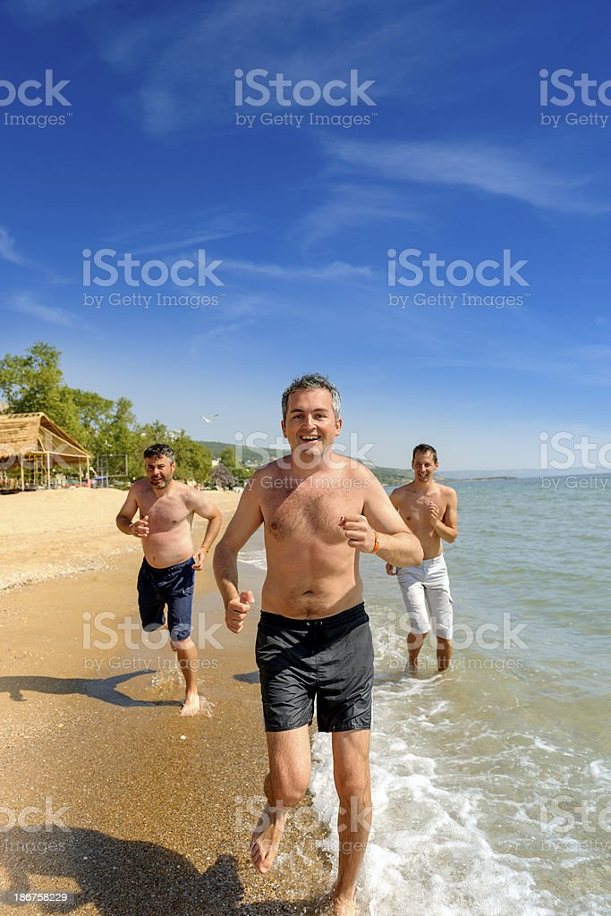 man running on beach royalty-free stock photo