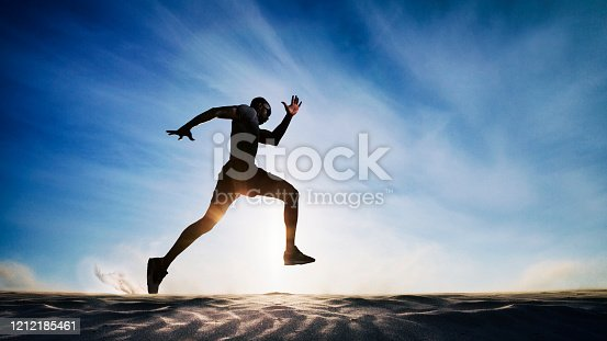 Man running on sand dunes.