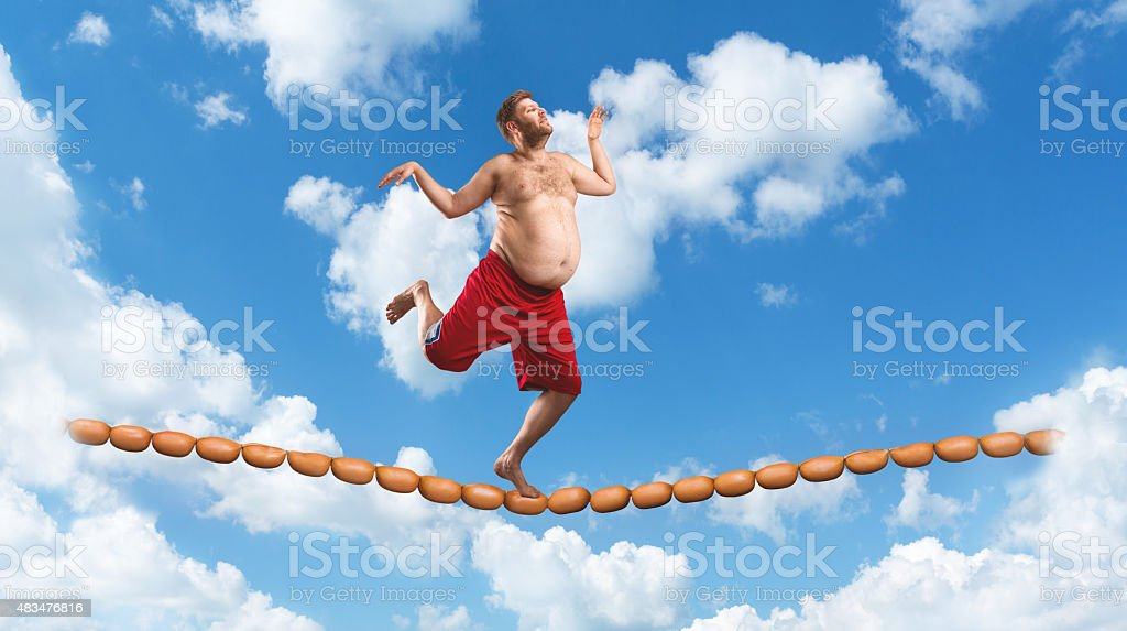 Man running on the sausage rope stock photo