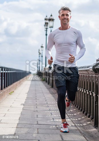 istock Man running outdoors 519030373