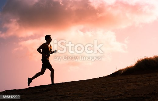 istock Man running outdoors 636342222