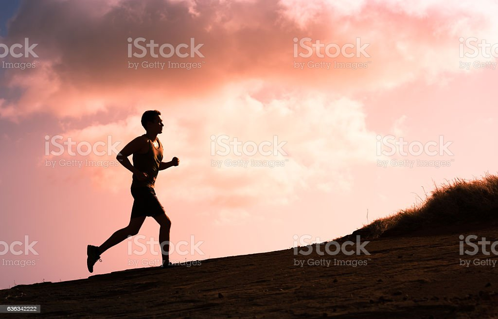 Man running outdoors stock photo