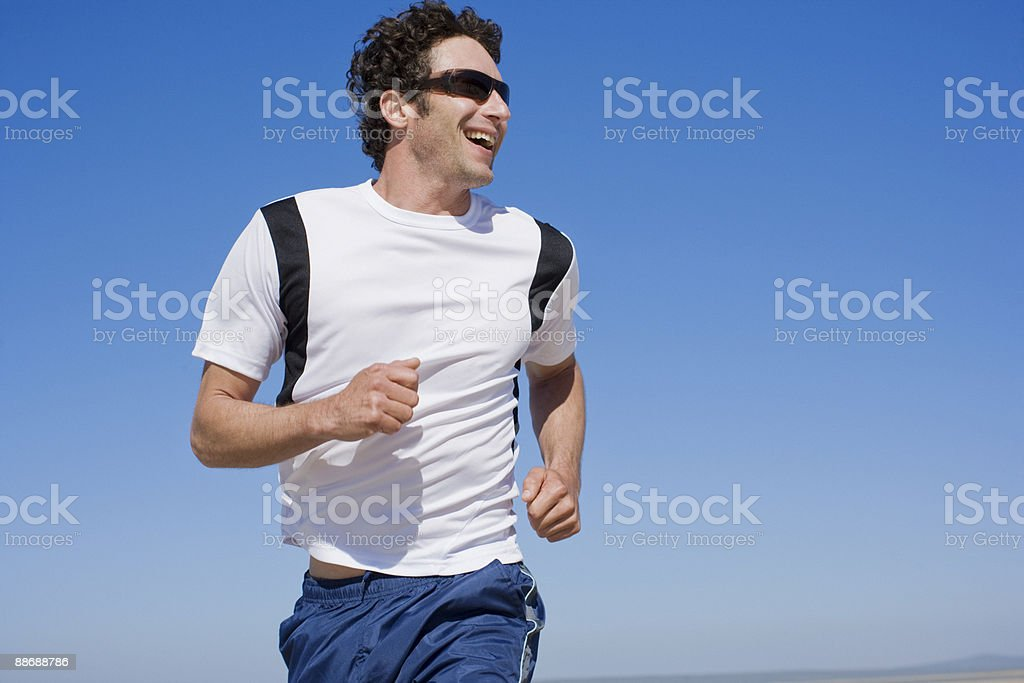 Man running outdoors royalty-free stock photo